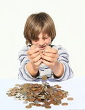 Boy pooring money Stock Photo