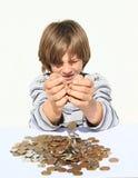 Boy pooring money Stock Photo