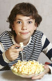Boy with pop corn plate close up smile photo Royalty Free Stock Photos