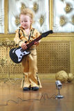 Boy in pop retro suit playing the guitar Royalty Free Stock Image