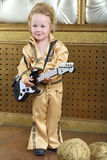 Boy in pop retro suit playing the guitar Stock Photo