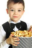 Boy with popcorn Royalty Free Stock Images