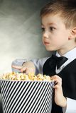 Boy with popcorn Royalty Free Stock Photos