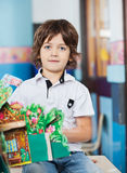 Boy With Popup Book Sitting On Desk In Classroom Royalty Free Stock Photos