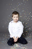Boy portrait. Portrait of cute boy in a studio with confetti Stock Photography