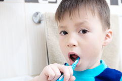 Boy portrait brushing teeth, child dental care, oral hygiene concept, child in bathroom with tooth brush Royalty Free Stock Photography
