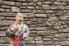 Boy laughing ethnic robe Royalty Free Stock Photo