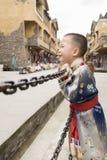 Smile boy ethnic robe Stock Images