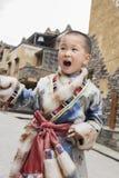 Boy laughing ethnic robe Royalty Free Stock Photos