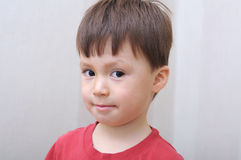 Boy portrait looking sly Royalty Free Stock Photo
