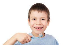 Boy portrait with lost tooth on toothbrush Royalty Free Stock Photos