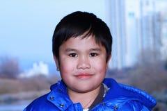 Boy portrait on natural background Stock Photo