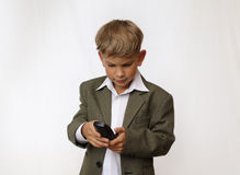 Boy portrait with phone stock photos