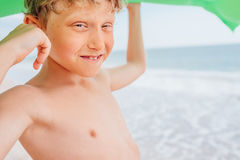 Boy portrait on the sea beach with swiming mattress Stock Photography