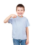 Boy portrait with toothbrush and lost tooth Royalty Free Stock Image