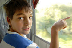 Boy portrait by train window Stock Photo
