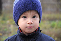 Boy portrait in warm clothes Stock Images
