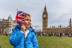 Boy portrait in Westminster, Big Ben Stock Photo