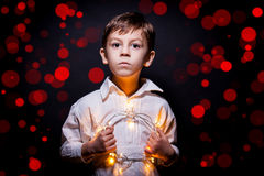 Boy portrait whit christmas lights Royalty Free Stock Images
