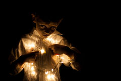 Boy portrait whit christmas lights Royalty Free Stock Image