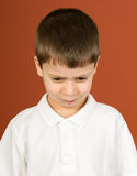 Boy portrait in white shirt on brown Royalty Free Stock Photo