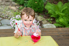 Boy Poses With His Pink Easter Egg Stock Photography