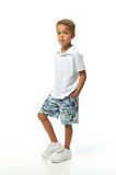 Boy posing. With hands in his pocket royalty free stock photography