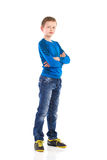 Boy posing with arms crossed. Full length studio shot isolated on white royalty free stock photos