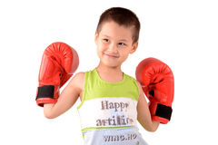 Boy posing with boxing gloves. Boy posing in large red boxing gloves stock photos