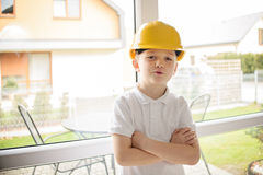 Boy posing with an engineering helmet Royalty Free Stock Photography