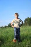 Boy posing with football ball Stock Photography