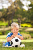 Boy posing with his ball in the park Royalty Free Stock Photos