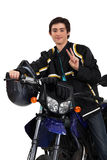 Boy posing with his motorcycle Stock Photography