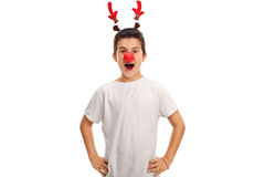 Boy posing with red antlers and a red nose Royalty Free Stock Photos