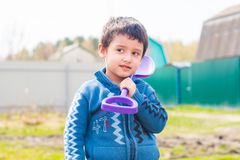 Boy posing with shovel. Boy 4 years old with a baby shovel outdoors Stock Photos
