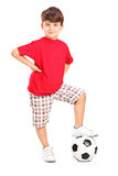 Boy posing with a soccer ball Royalty Free Stock Photo