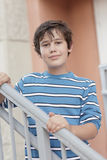 Boy posing on a staircase Stock Images