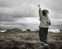 Boy posing. A young boy posing in a lava field Royalty Free Stock Photography