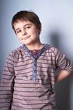 Boy posing. Younh happy boy in casual wear posing in studio, vertical portrait stock photos
