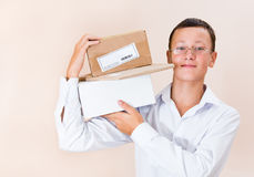 Boy postman with a parcel. On his shoulder Stock Photography