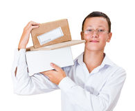 Boy postman with a parcel. On his shoulder Stock Photo