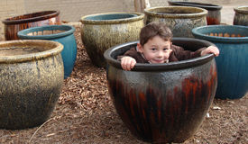 Boy in the pot Stock Photography