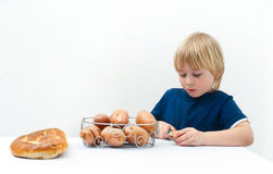 Boy with potatoes Stock Images