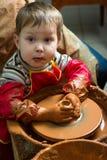 Boy potter Royalty Free Stock Image