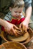 Boy potter Stock Image