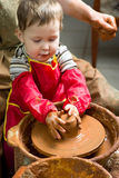 Boy potter at work Stock Photography