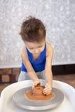 Boy potter at work Stock Photo