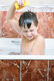 Boy pouring water Royalty Free Stock Photos