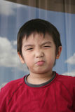 Boy pouting. Little naughty boy in red tee pouting Royalty Free Stock Photo