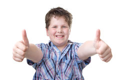 Boy with Power thumbs up, isolated on white Stock Image